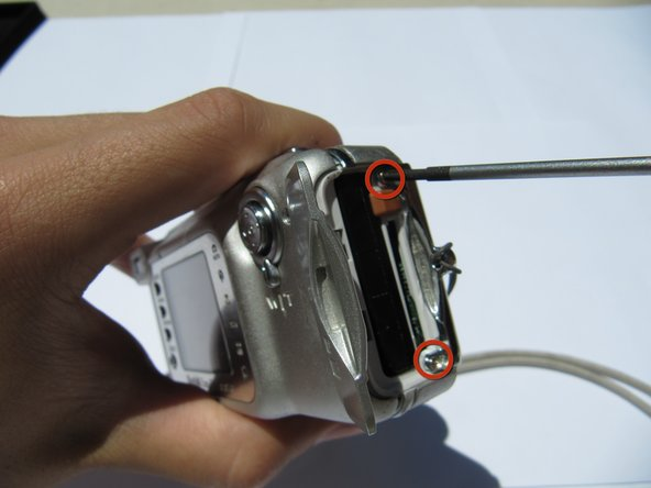 Using a Phillips #00 screwdriver, remove two (5.39 mm) screws next to the battery slot.