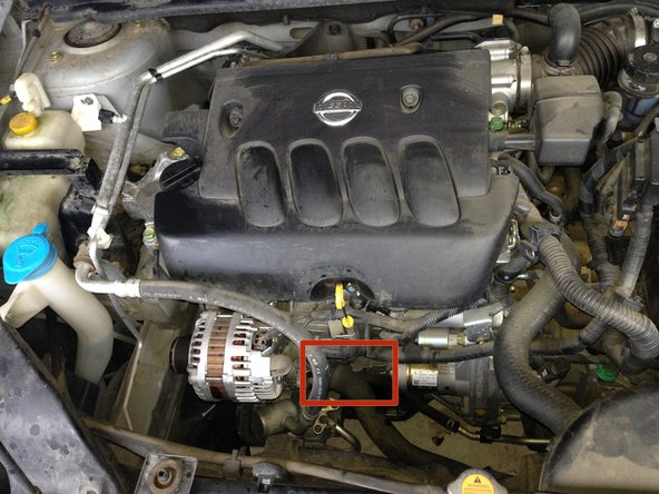 Locate the oil filter from either above or below the car (The images are from above).