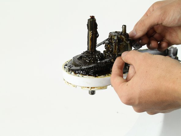 Lift the gasket up with your hands or a spuger and remove it.