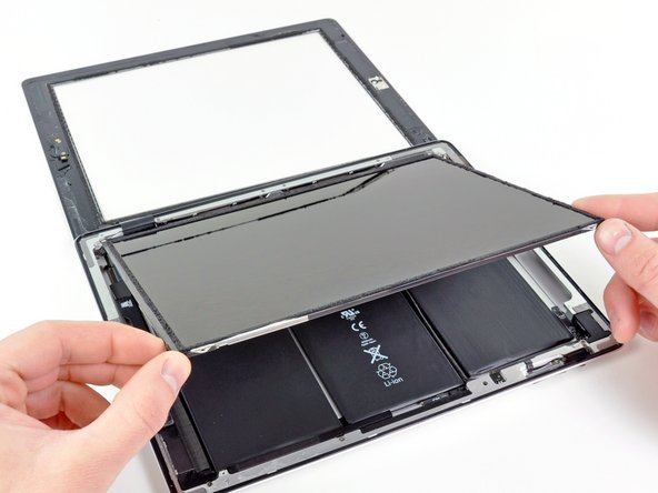 The front panel ribbon cables are connected beneath the LCD. To access them, you'll need to temporarily flip the LCD over and out of the way.