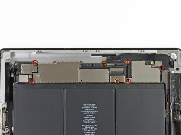Remove the following seven screws securing the logic board to the rear aluminum panel.