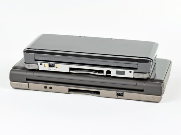 Here's how it stacks up to the Nintendo DSi XL. Note that it trades a smaller footprint for a bit of a thicker casing.