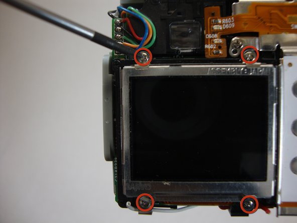 Using a Phillips #00 remove the four 4.40 mm screws that secure the LCD screen to the frame.