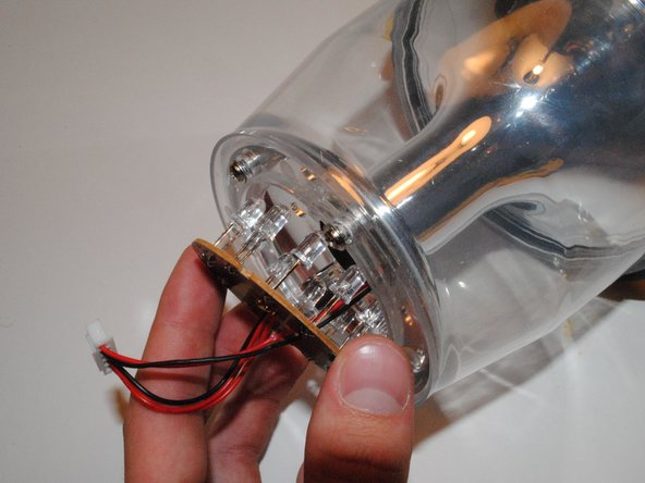 Making sure both halves of the lantern are detached from the globe, pull LED board out of the base of the globe. Be careful not to damage any LED connected to the board.