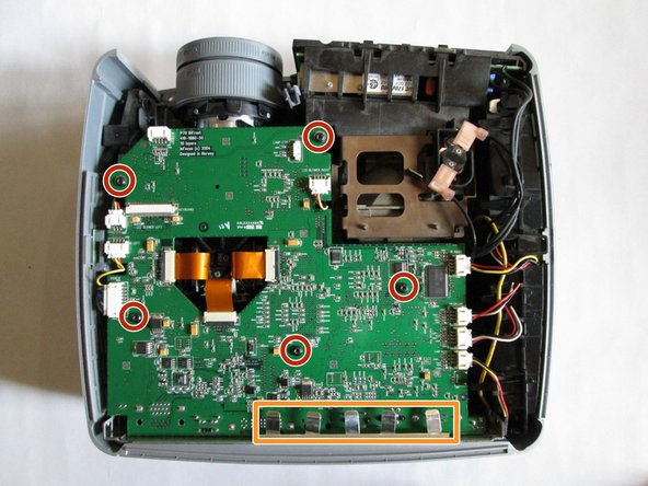 Use the T10 Torx screwdriver to remove the five 5mm screws located throughout the motherboard.