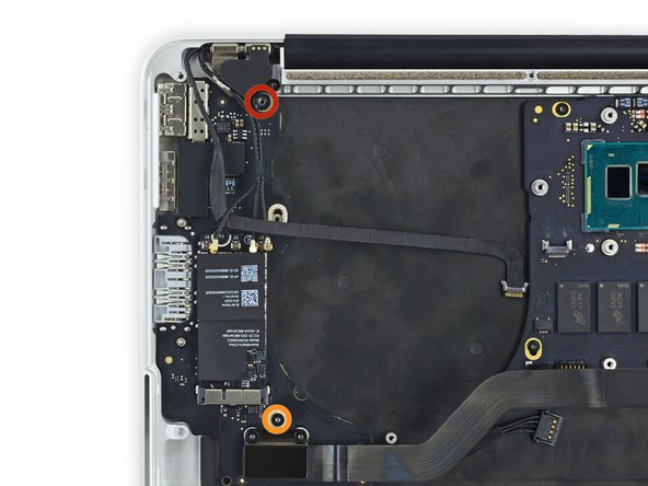 Remove the following screws securing the I/O board to the upper case: