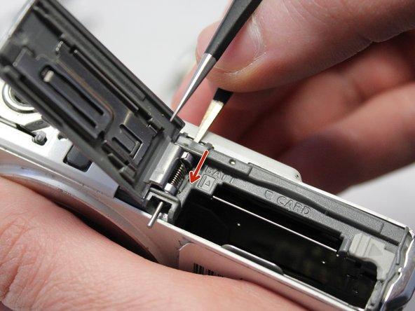 Push the metal bar down using the metal tweezers.