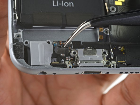 Remove the plastic microphone bracket.