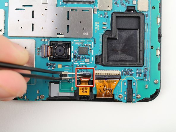 Use the tweezers to lift the switch connecting the front camera to the motherboard.