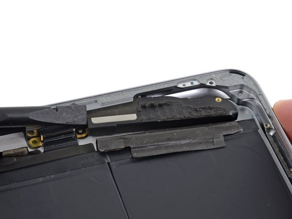 Push from the Lightning connector end with the flat end of a spudger to free the speaker from the lip of the rear case.