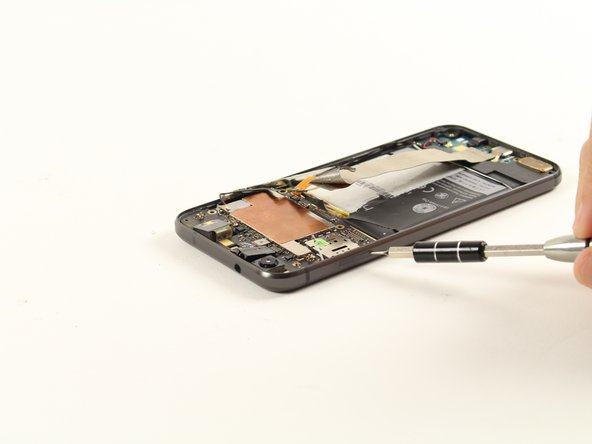 Use a SIM ejection tool to remove the SIM card tray located at the top left of the device.