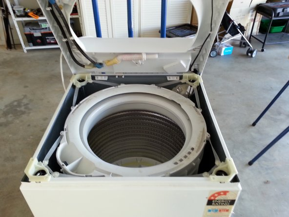 Once you have replaced all of the suspension rods and rubber straps you can reassemble the washing machine cover and lid. Then you are finished. My washing machine ran beautifully after I completed this repair. Best of luck to you.