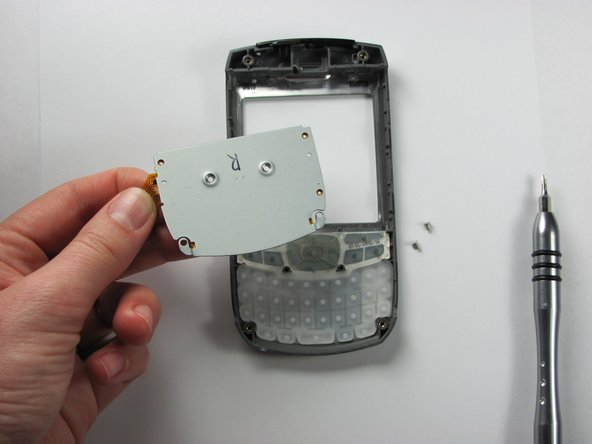 Take off the plastic back panel, in order to gain access to the rubber keys of the keyboard.