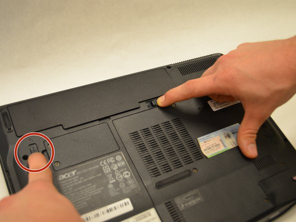 Ensure that the battery compartment lock tab is in the unlocked position.