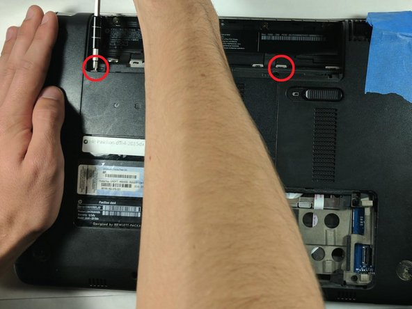 Use a Phillips screw driver to remove the the two screws that hold the service cover in place.