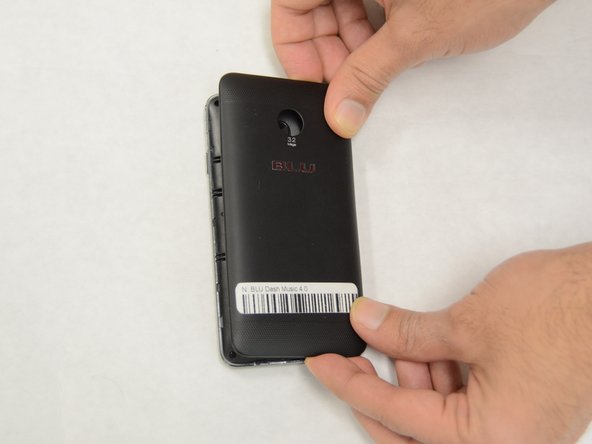 User your fingers or a plastic opening tool to remove the back cover.