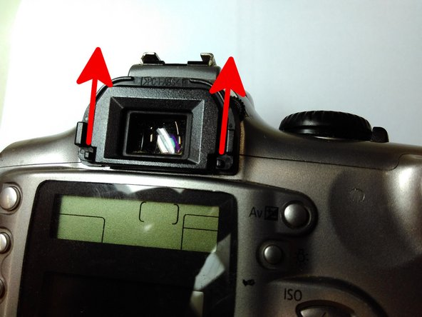 Remove the eyecup by gently pushing it upwards, so it doesn't block us in the final step of pulling the back casing from the camera's body.