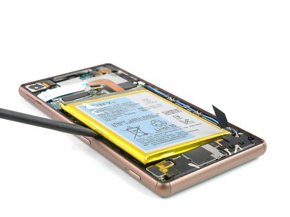 Use a spudger on the left side of the frame to lever out the battery.