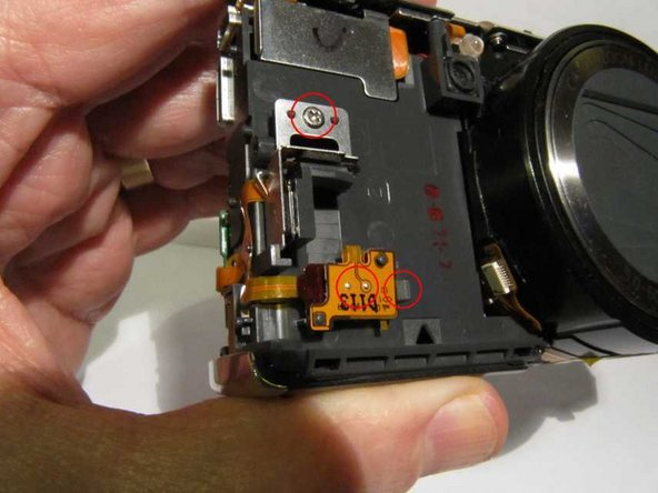 On the front of the camera you will now be able to see two accelerometers mounted at right angles, and beneath them the backup battery. It is not necessary to dismantle any of these unless they are suspect.
