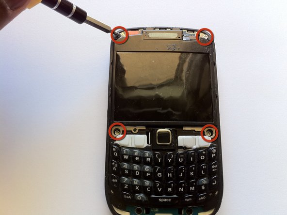 Remove four T6 Torx screws from the front of the phone.