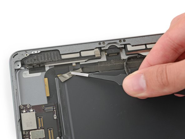 Peel the tape toward the home button to uncover the speaker cable connector.