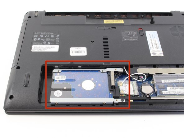 Once the cover panel is off, locate the hard drive.