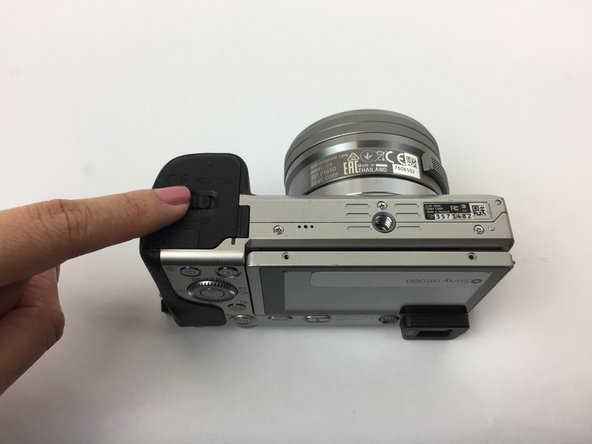 Flip the camera around to access the battery compartment.