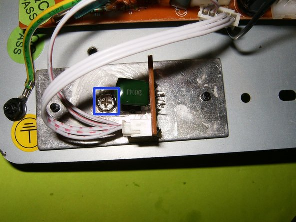 Reapply a thin coat of thermal paste to the back of the IC. Use a self tapping screw to attach it to the heatsink.