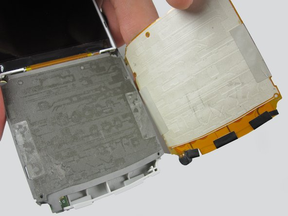 The keypad will lift off the adhesive.