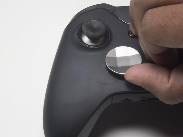 Flip the controller so that the buttons are face up to prevent the vibration motors from falling out of the controller.