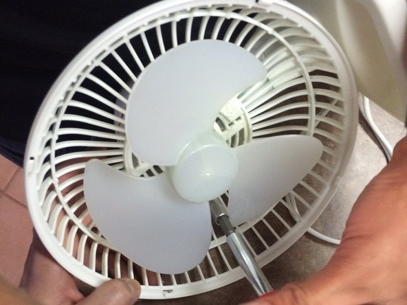 """Remove the 3 screws holding the fan on to the motor housing using a 3/16"""" philips head screw driver. The length of the screwdriver does not matter."""