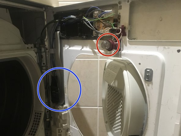 The plastic packet at the bottom of the drier contains a schematic and a wiring diagram.
