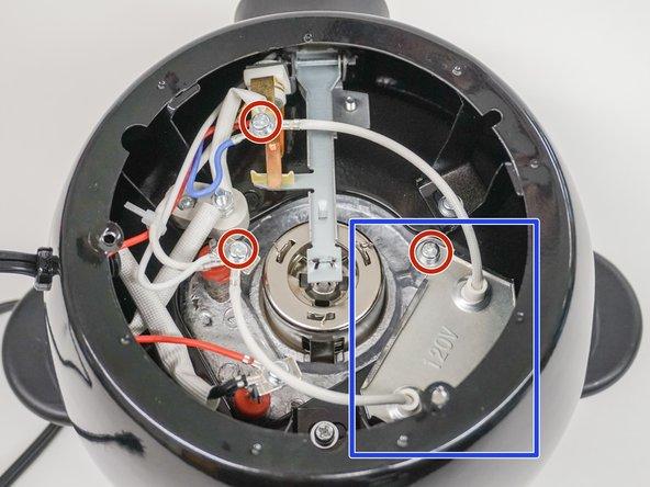 Remove the three Phillips screws