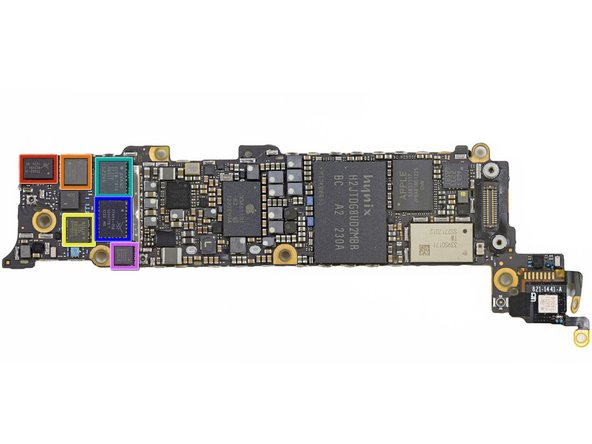The underside of the logic board is teeming with components.