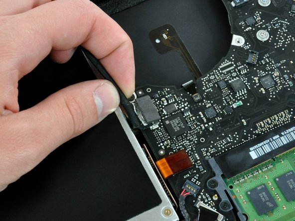 Remove any adhesive from the camera cable connector.