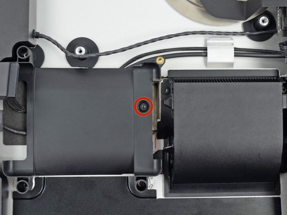 Remove the single 7.2 mm T10 screw securing the hard drive tray to the rear enclosure.