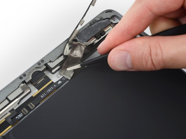 Continue peeling up the tape away until there is enough slack in the left speaker cable to disconnect it.