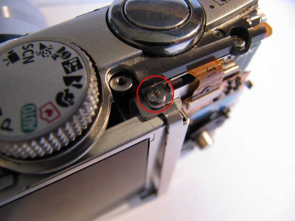 Remove a screw from the top right hand end of the LCD frame and remove the LCD clamp.