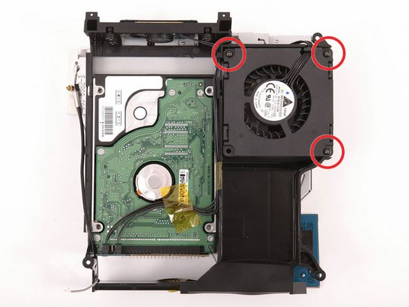 Remove the three long, black Phillips screws from the corners of the fan. These screws are strongly threaded, and will offer significant resistance.