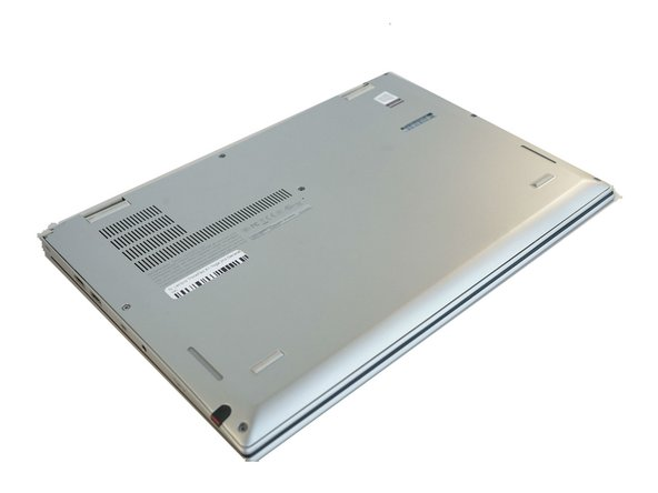 Ensure the laptop is powered off and the charging cable is disconnected before opening the back cover.