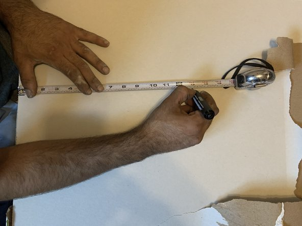 Use the tape measure to measure the drywall to fit the dimensions of the hole trimmed in step 1.