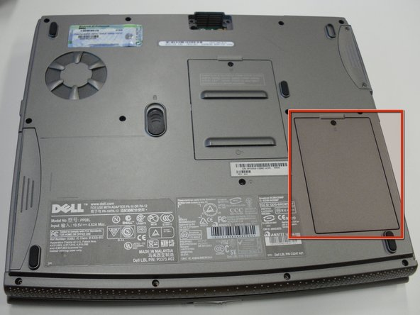 Turn the laptop upside down and  locate the panel labeled C.