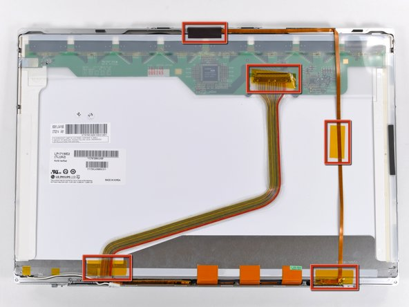 Remove the several strips of tape securing the ribbon cables to the LCD.