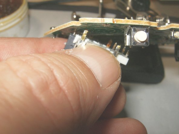 Pull off the 3D analog stick gently to ensure that all solder connections are unsoldered.
