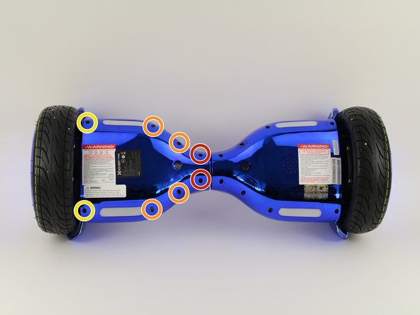 Using a Phillips #1 screwdriver, remove the two 14 mm screws closest to the center of the hoverboard.