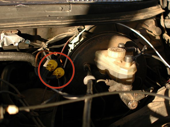 "Begin under the hood of the car, on the driver's side, back near the large round brake booster. You will see a yellow check valve with two connections coming from it. One connection is a 3-way ""Y"" connection with two yellow lines coming out of it. This is the feed for the vacuum door lock system."