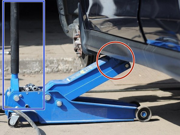 Place the floor jack on the jacking point, located on the passenger side behind the front wheel.
