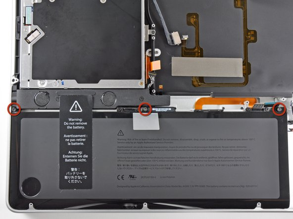Remove the three 6.5 mm Tri-point screws securing the battery to the upper case.