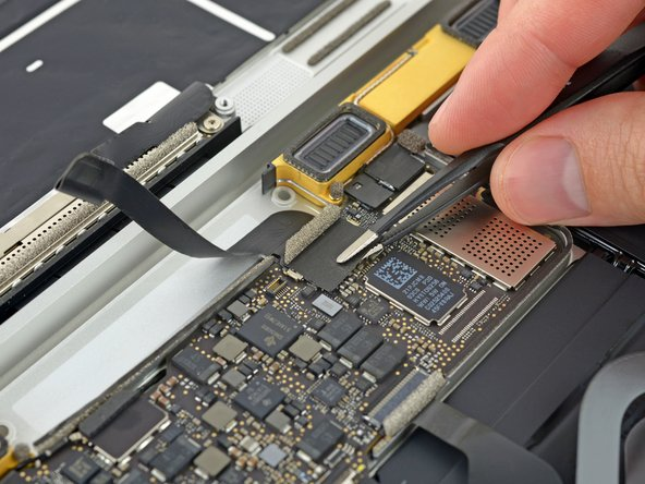 Use tweezers to peel back the tape covering the display cable connector.