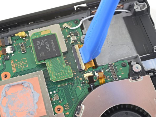 Use an opening tool, spudger, or your fingernail to flip up the small, hinged locking flap on the LCD ribbon cable ZIF connector.